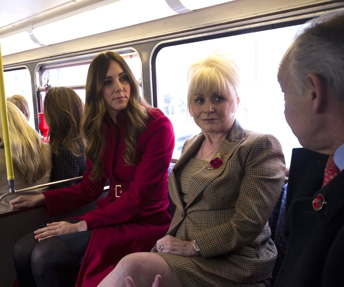 Duchess Catherine chats to members of the public while on a London bus in 2013. *(Image: Getty)*