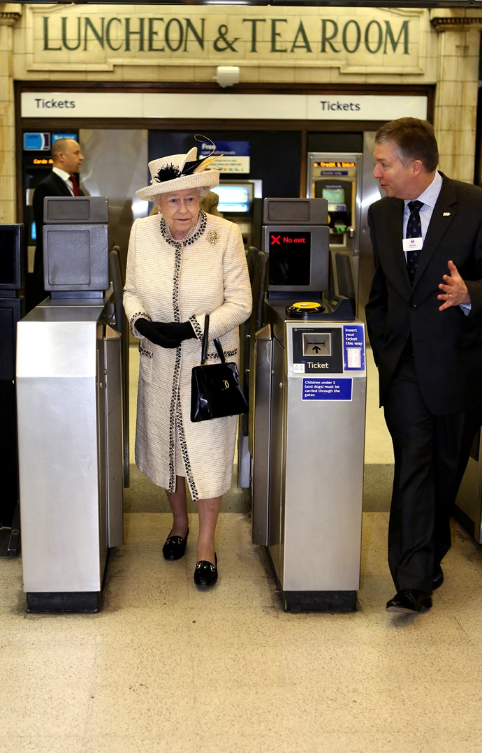 The Queen is let through the station barriers, no ticket needed! *(Image: Getty)*