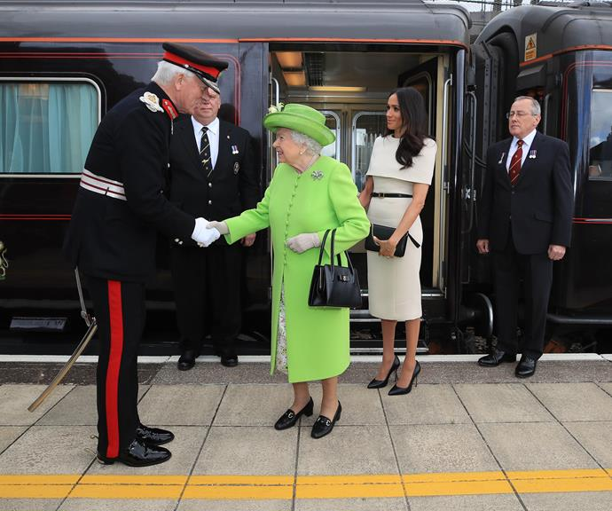The Queen and Duchess Meghan rode the royal train together during their first solo joint appearance. Too cute! *(Image: Getty)*