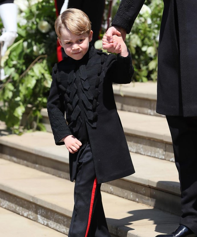 Lo-and-behold! Prince George sparingly wears long-legged pants. Another rare occasion was at Prince Harry and Duchess Meghan's royal wedding in May 2018 (pictured). *(Image: Getty)*