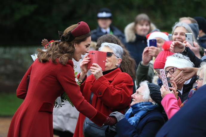 This burgundy design was fittingly festive as Kate stepped out to greet fans on Christmas morning. *(Image: Getty)*