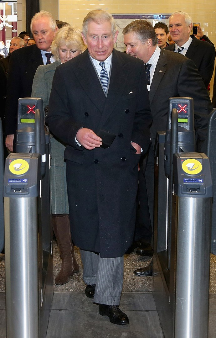 Do you reckon he has an Oyster card? Prince Charles taps off at a London train station. *(Image: Getty)*