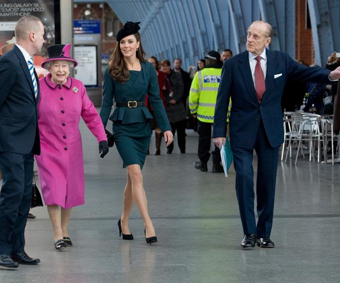 The gang's all together! The Queen, Duchess Catherine and Prince Philip at Leicester train station in London in 2012. *(Image: Getty)*
