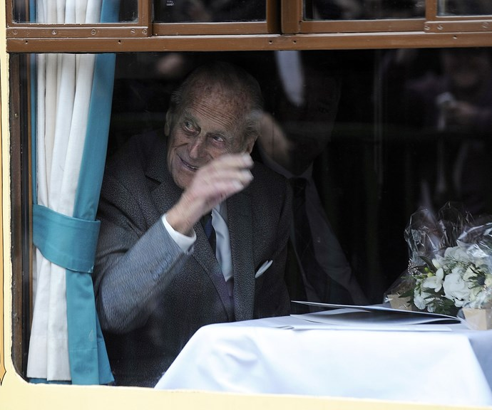 Prince Philip waving to fans while aboard the Royal Train in Scotland, 2015. Yep, the royal train is totally a thing! The train is used to transport senior members of the royal family around Great Britain. *(Image: Getty)*