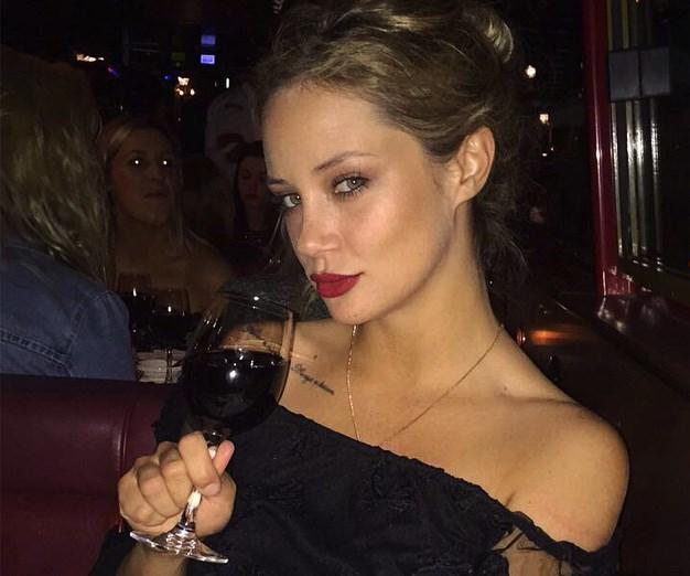 Jess tucking into a vino. *(Image: @jessika_power/Instagram)*