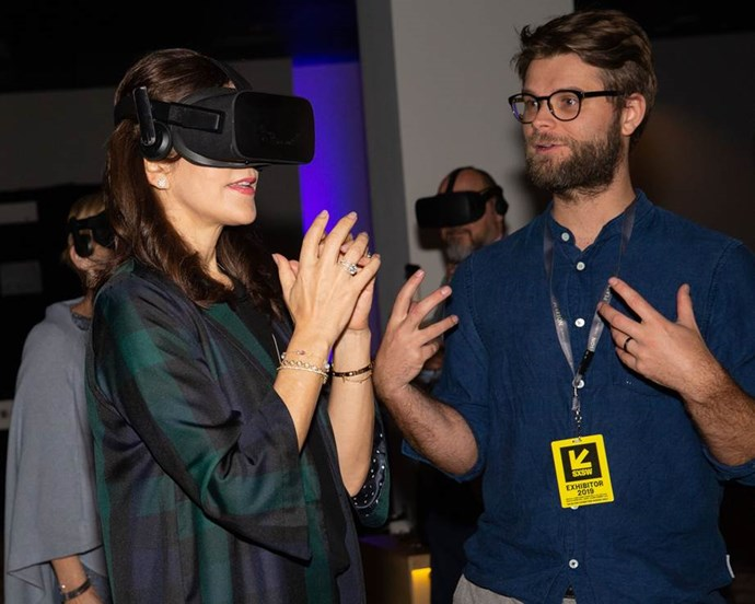 Princess Mary got into the thick of things in Texas by giving a pair of virtual reality goggles a go! *(Image: Getty)*