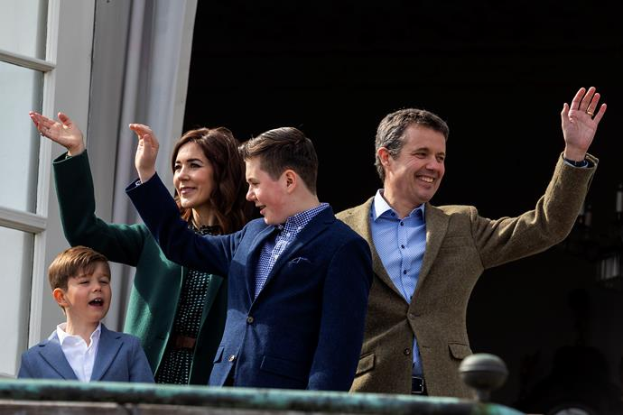 The Danish royals waved to hundreds of onlookers who flocked to catch a glimpse of them. *(Image: Getty)*