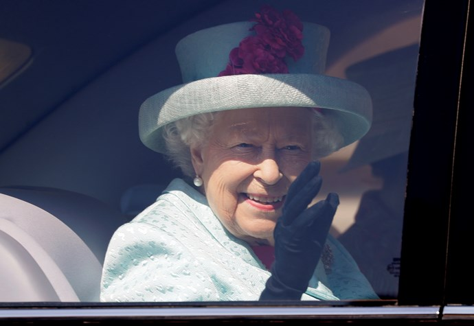 The Queen shows off her signature wave as she attends Easter Sunday service. *(Source: Getty Images)*