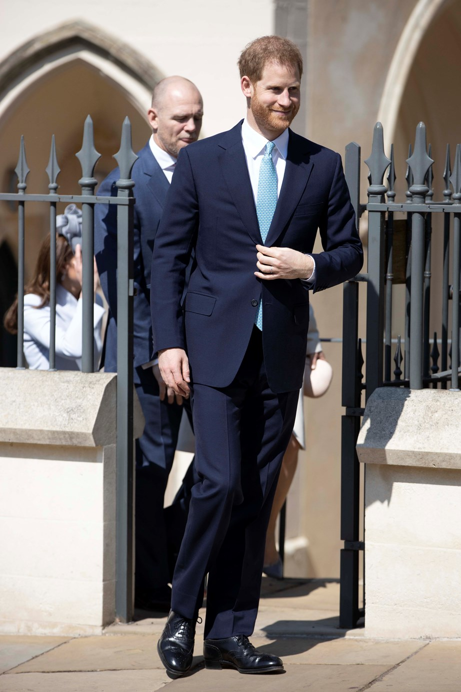 Prince Harry leaving the Easter Sunday service followed by Mike Tindall. *(Image: Getty)*