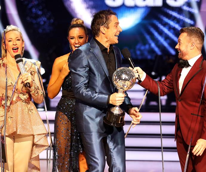 Accepting the winner's trophy from host Grant Denyer. *(Image: Channel 10)*
