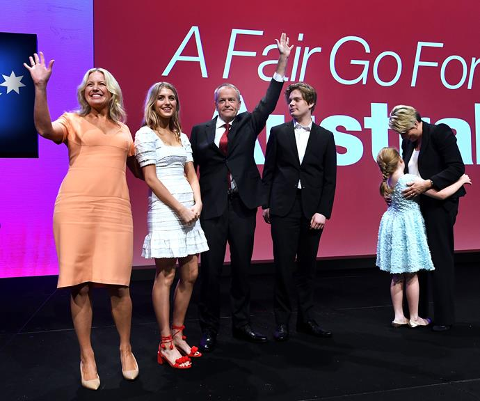 Chloe Shorten (left) with her daughter Georgette, Bill Shorten, Chloe's son Rupert and the couple's daughter Clementine, playing with Bill's Labor colleague Tanya Plibersek. *(Image: Getty)*
