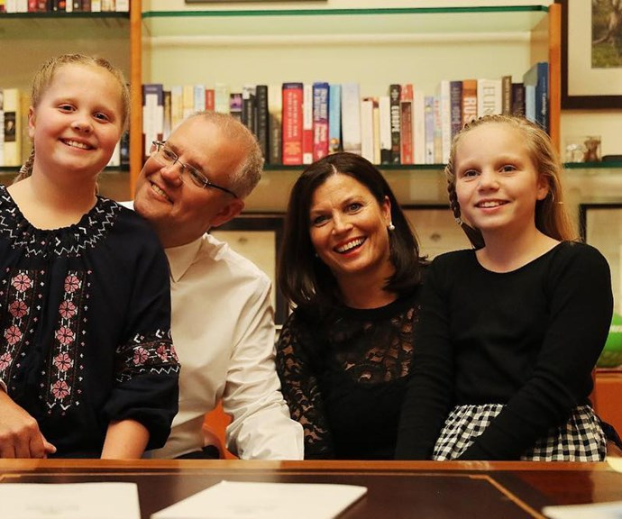Scott and Jenny Morrison with their daughters Abby (left) and lily (right) in their father's office in Parliament House, Canberra. *(Image: Getty)*