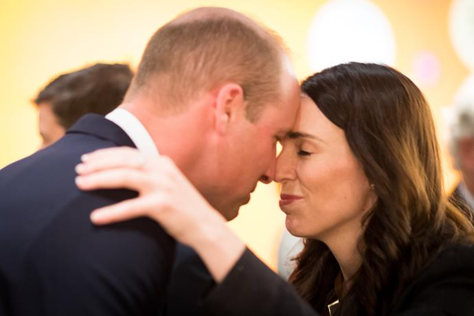 Wills shared a hongi, a traditional Maori greeting, with Kiwi PM Jacinda Ardern at the moving service. *(Image: Getty)*