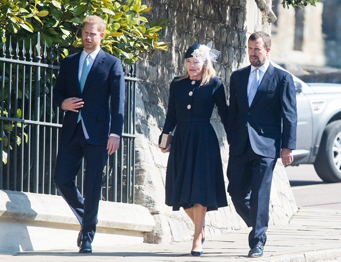Prince Harry walks away from the main group. *(Image: Getty)*