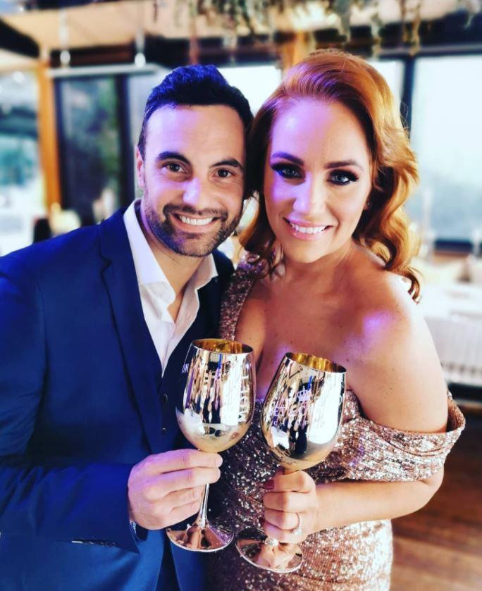 Cam Merchant and Jules Robinson at their engagement party last weekend. *(Source: Instagram/julesrobinson82)*
