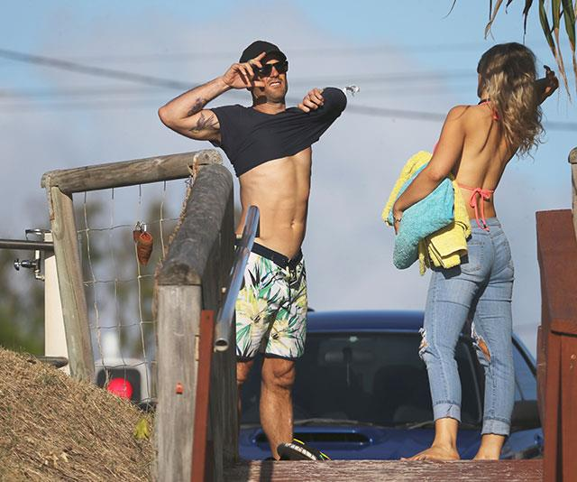 Mike and Jess suss out the surf. *(Image: Exclusive/Instar)*