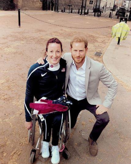 Prince Harry looked relaxed and happy as he posed for photos with Marathon participants. *(Image: Instagram)*
