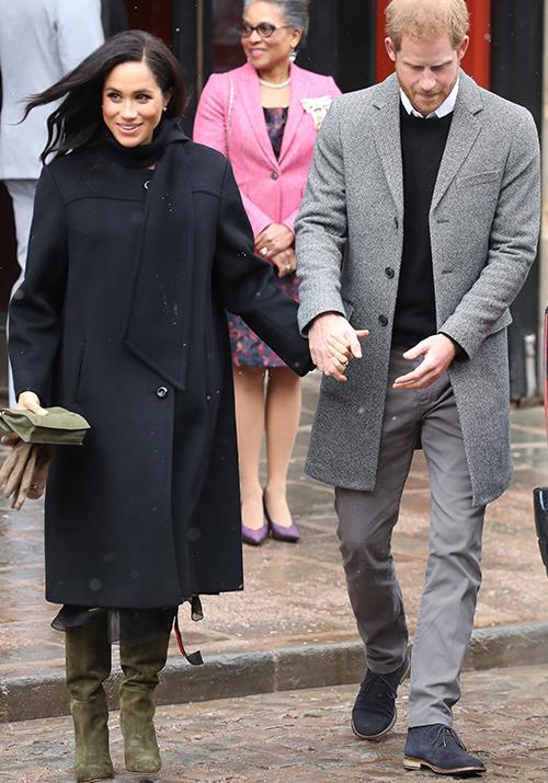 Meghan wrapped up for the snow in this William Vintage wool coat. *(Image: Getty)*