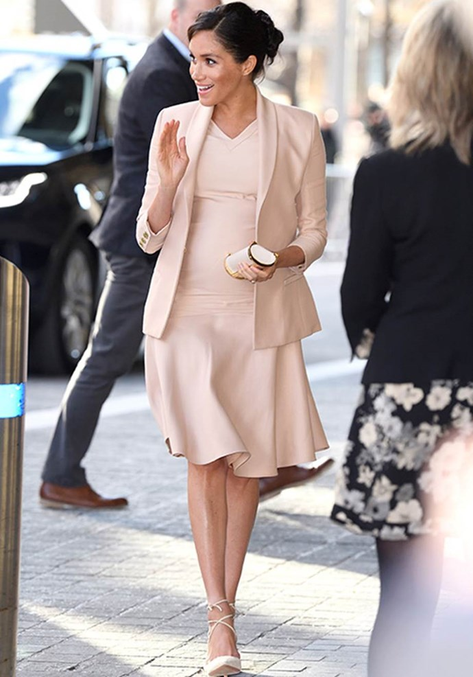 Meghan's Brandon Maxwell dress and blazer ensemble looked seamless as she stepped out in London towards the end of her pregnancy. *(Image: Getty)*