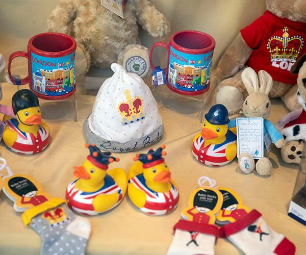 The shop window of Glorious Britain near Windsor Castle has been decked out with all sorts of royal baby merchandise. *(Image: Getty Images)*