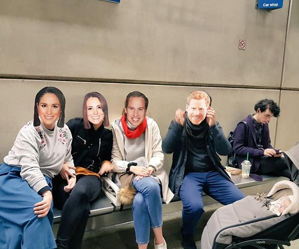 One group of royal fans was snapped at London's St Pancras Station wearing masks of Harry, Meghan, Will and Kate. *(Image: Twitter @Ibilola_Amao)*