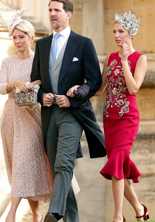 **Princess Maria-Olympia of Greece** <br><br> And yes, you've definitely seen her before! She attended none other than Princess Eugenie's wedding in October 2018 wearing this fashion-forward headpiece and bold midi-dress.