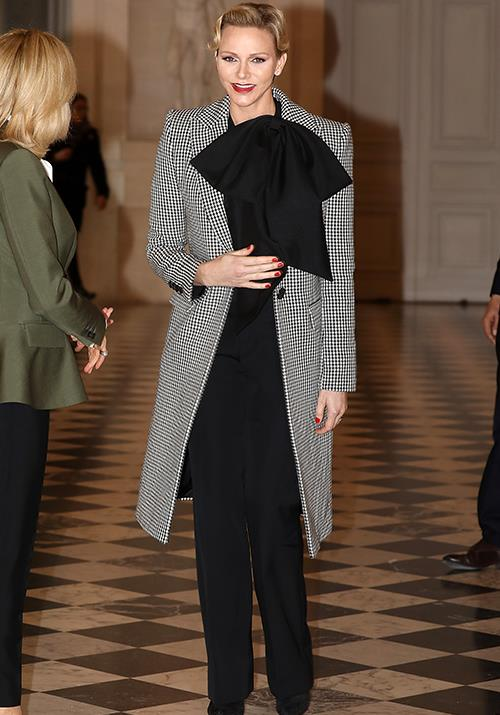 **Princess Charlene of Monaco** <br><br> In a sentence we never thought we'd utter, Princess Charlene proved a hounds-tooth print and giant bow *can* go hand-in-hand as she attended a luncheon in 2017. *(Image: Getty)*