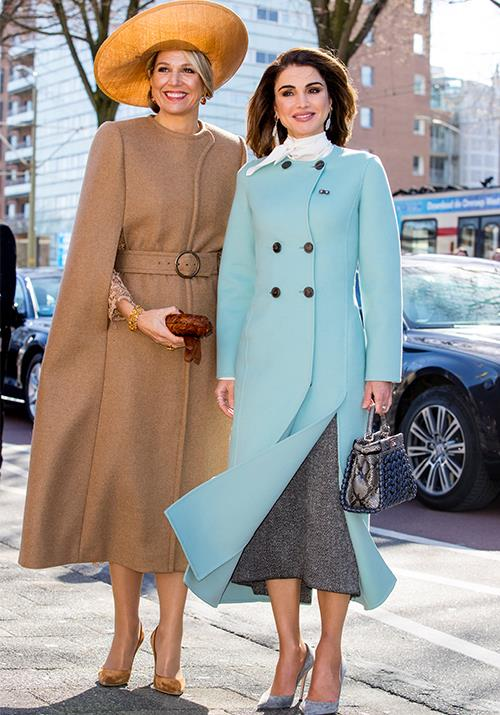 **Queen Rania of Jordan** <br><br> Joined by fashionable fellow Queen Maxima of The Netherlands, Rania's visit to the Gemeentemuseum Den Haag museum in 2018 was a fashion moment we'll remember for a while to come.