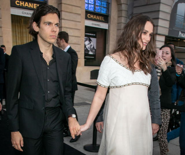 Keira Knightley debuted her gorgeous bump at Chanel-hosted cocktail party in Paris with her husband, James Righton on Thursday. *Image: Getty.*