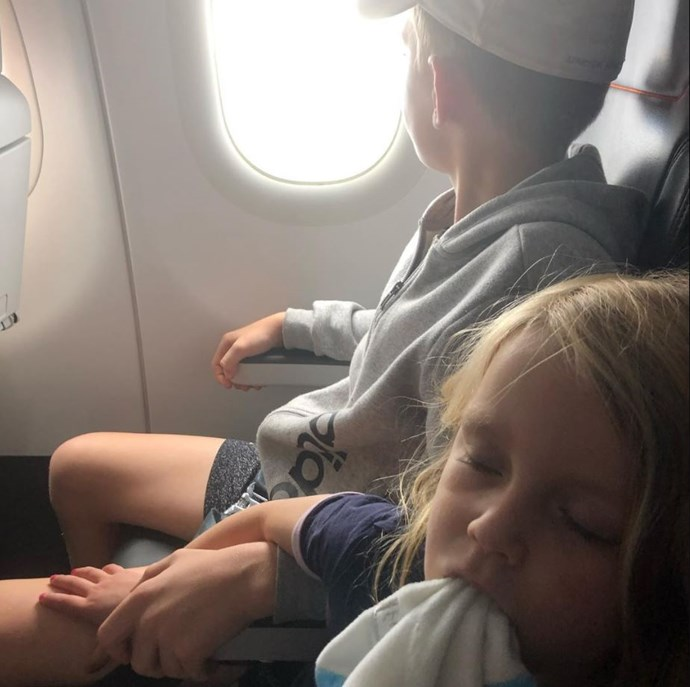 Looks like this trip tired little Evie out! At least she had her big brother to hold on to. *(Image: Instagram @walkschris21)*