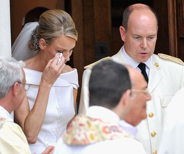 Charlene wipes away tears on her wedding day. *(Image: Getty)*
