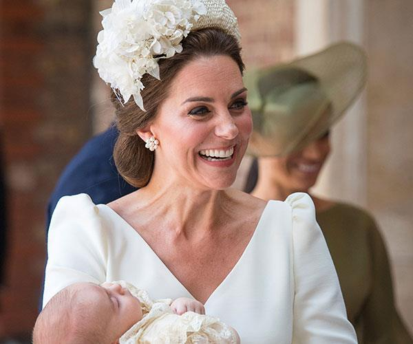 Duchess Catherine beams as she carries in a sleeping and peaceful 11-week-old Prince Louis for his christening last year. *(Image: AAP)*