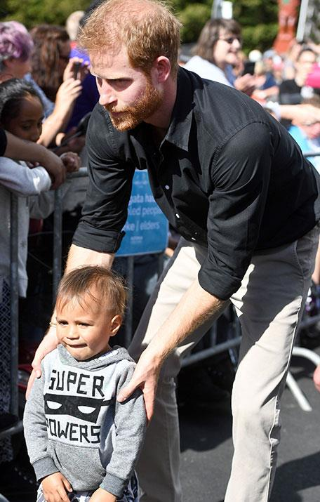 Harry is a natural with kids and it would be amazing to see him share the magic of the Invictus Games with his little one. *(Image: Shutterstock)*
