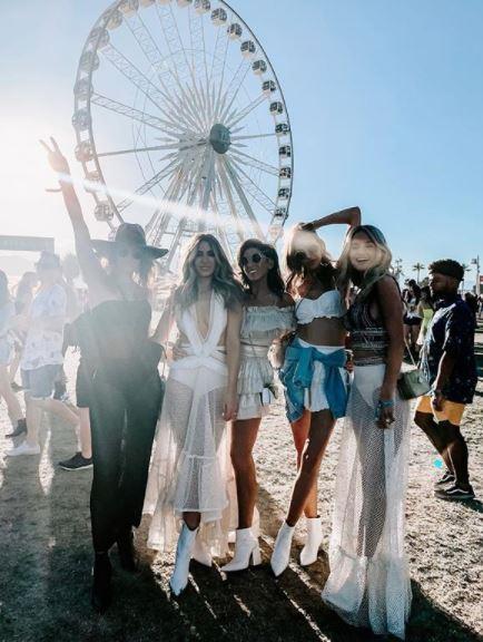 Bec, second from left, fully embraced the white cowgirl boot craze at this year's Coachella festival along with her pals. *(Image: Instagram / @becjudd)*