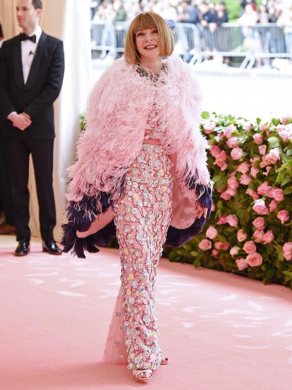 The queen is here! Host Anna Wintour looks radiant in pink feathers. *(Image: Getty Images)*