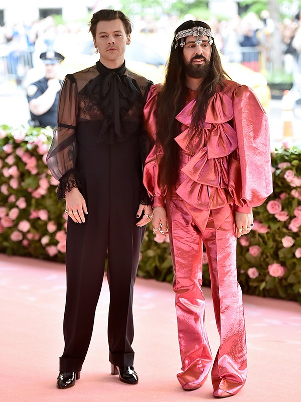 He's not in One Direction any more! Host Harry Styles is bringing that high fashion and we are loving Alessandro Michele's pink look too. *(Image: Getty Images)*