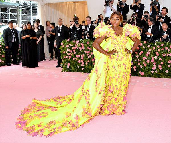 Serena Williams who is also hosting makes bright yellow look red hot. *(Image: Getty Images)*