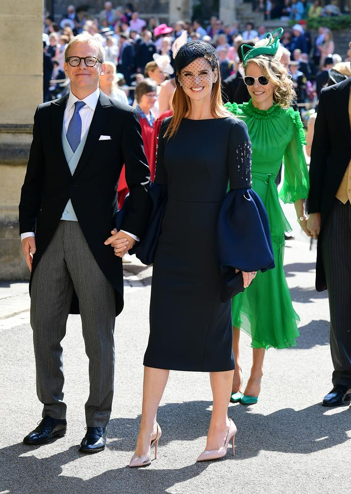 Sarah Rafferty and her partner looking stunning at Harry and Meghan's wedding last year. *(Image: Getty)*