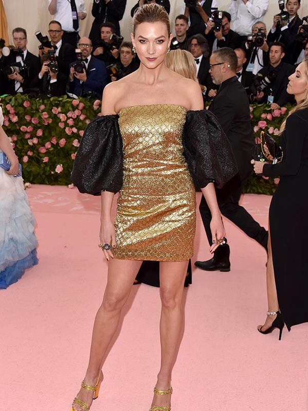 Supermodel and coder Karlie Kloss kept things relatively simple in black and gold. *(Image: Getty Images)*