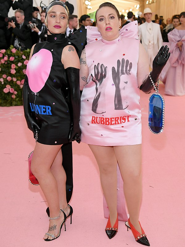 "It's called ""fashun"". *Girls* stars, Jemima Kirke and Lena Dunham on the pink carpet at the Met Gala. *(Source: Getty Images)*"
