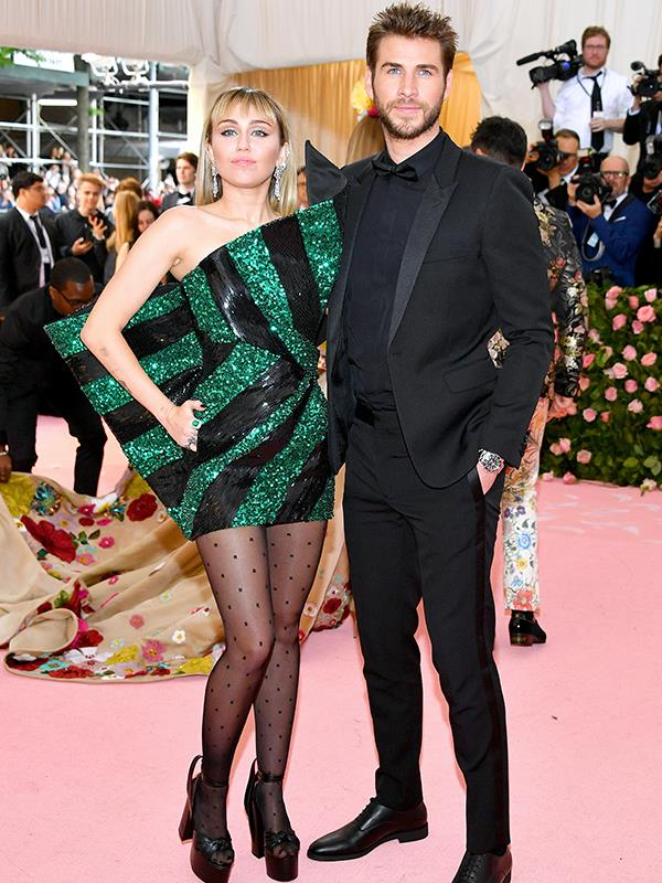 Liam Hemsworth rocked up with his favourite pressie of all time, his wife Miley Cyrus. *(Source: Getty Images)*
