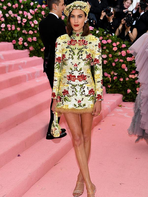 Shower caps and short skirts. Alexa Chung on the pink carpet. *(Source: Getty Images)*