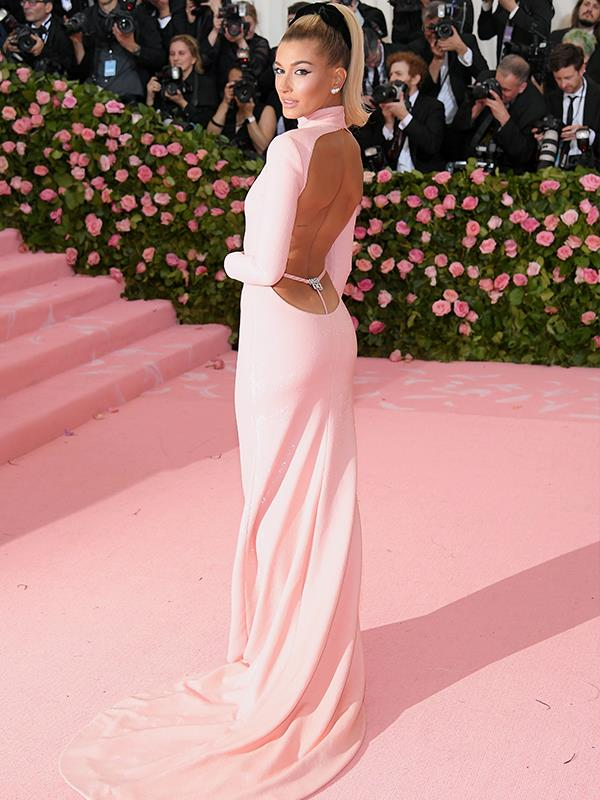 Bieber Barbie. Hailey Bieber camouflages herself onto the pink carpet. *(Source: Getty Images)*