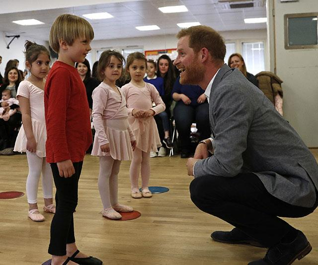 Harry seriously lights up when he's around little ones. Here, he shares a special moment with a little boy during an event ballet class  while on a visit to YMCA South Ealing in west London in April. *(Image: Getty)*