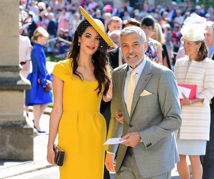 Amal and George Clooney at the royal wedding last year. *(Image: Getty)*