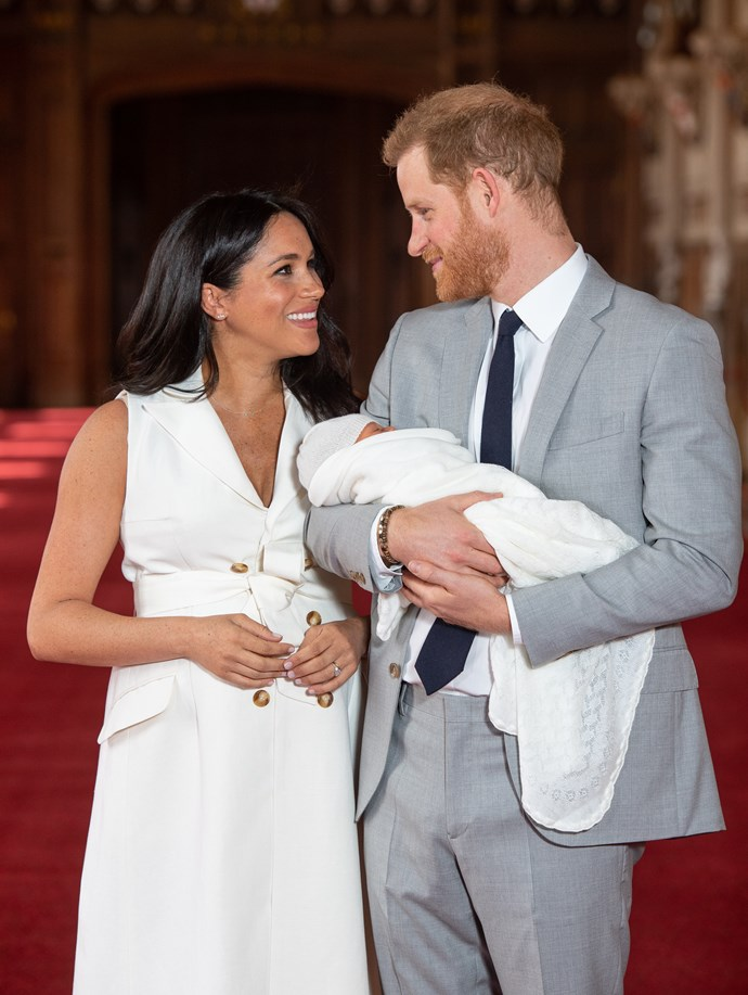 Meghan resting her hands on her gorgeous post-partum stomach. *(Image: Getty)*
