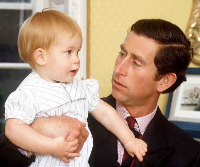 An adorable Prince Harry as a tiny tot, with his father Charles, the Prince of Wales. *(Image: Getty)*