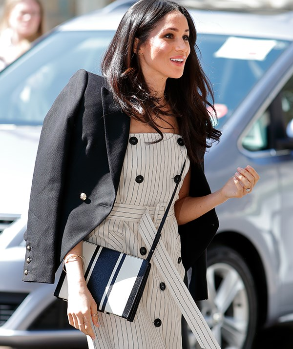 Meghan's a pro at pulling off the tuxedo look! *(Image: Getty)*