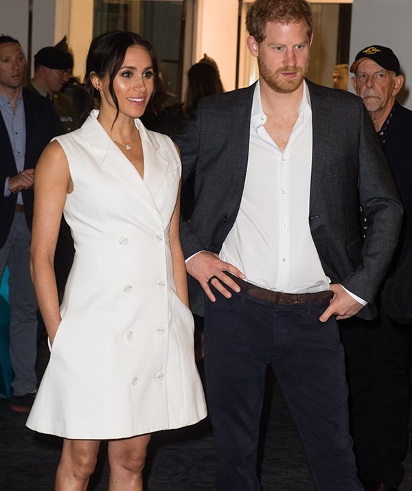 Meghan's white Maggie Marilyn tuxedo dress worn while visiting Wellington, NZ in October 2018 was a fan favourite. *(Image: Getty)*