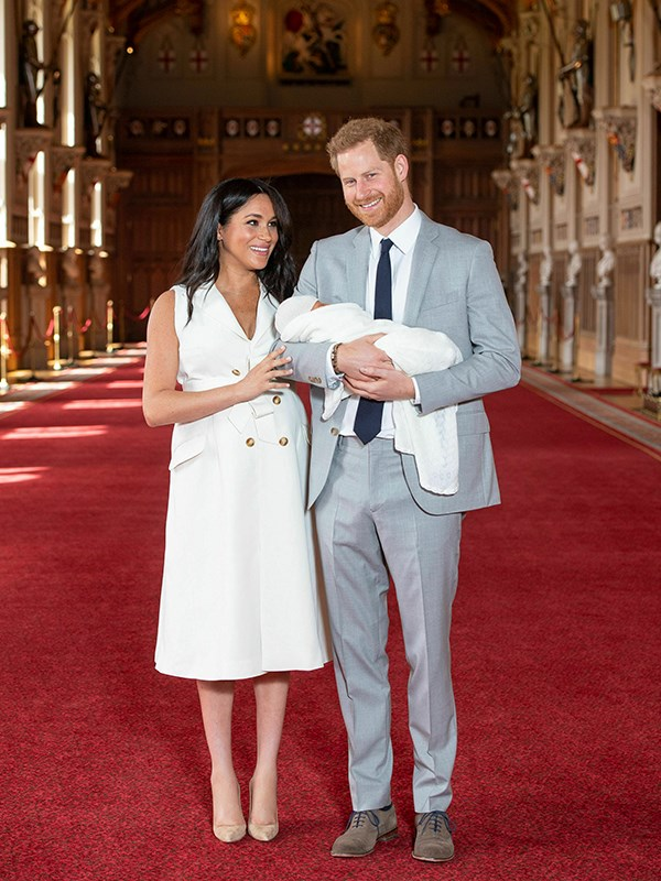 Meghan's stunning white dress held a special significance that you might have missed. *(Image: Dominic Lipinski / PA / Getty)*